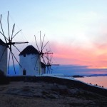 Whitewashed windmills at sunset