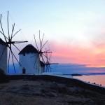 Whitewashed windmills at sunset
