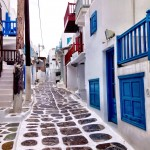 The cobbled pathways and blue and white shops of Mykonos
