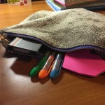 I never leave home with out my pencil pouch. It has anything I could really ever need including highlighters, tape and sticky notes.