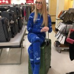 When mom is nice enough to buy you Detroit Lions pajamas and a new suitcase for your trip, you model it in the store if she asks you to.