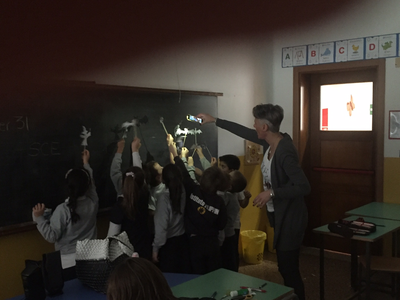 Students having fun with their Halloween shadow puppets!