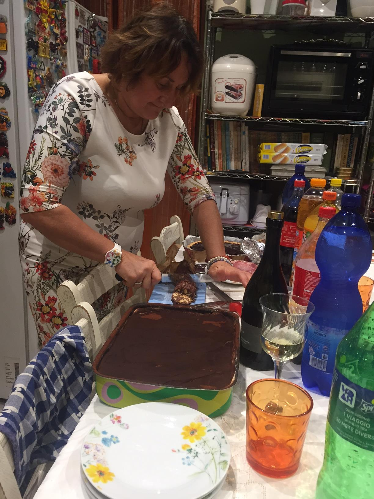 My host mom cutting our many desserts.